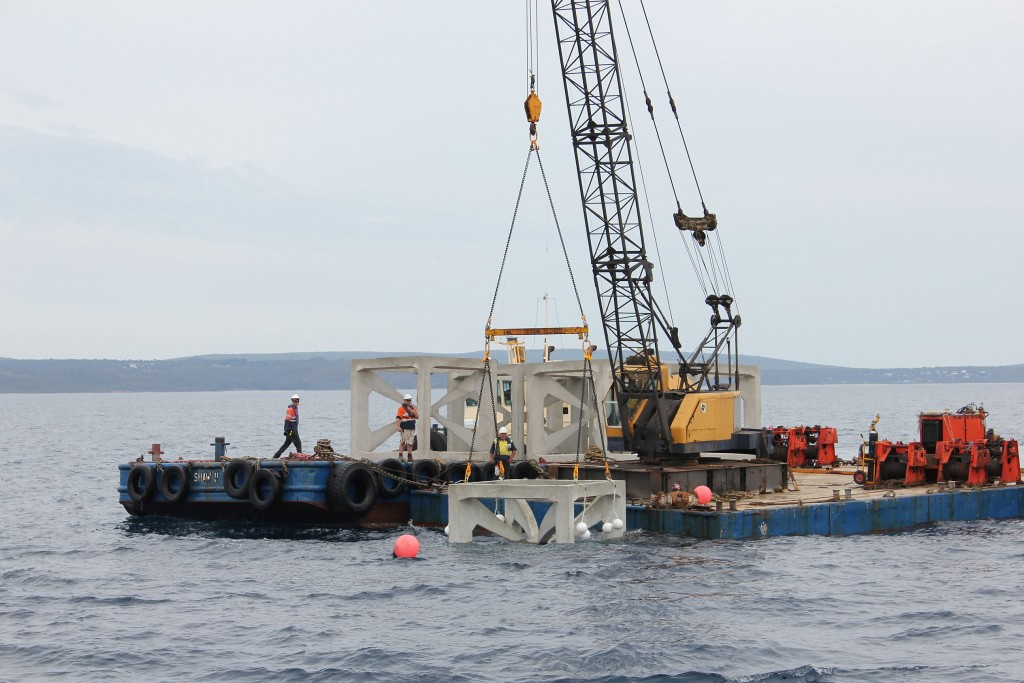 Artificial reef deployment barges