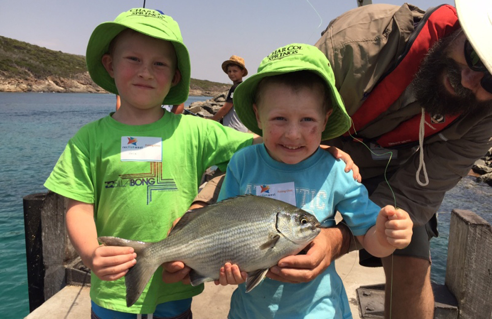 Kids enjoying a free school holiday fishing clinic
