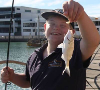 Fishability kid with his catch