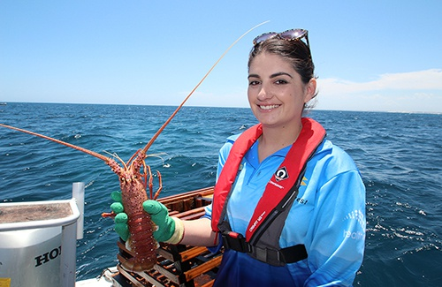 Boat fisher wearing lifejacket