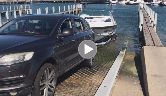 Car and boat on boat ramp